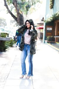 Outfit Inspiration: Camouflage Jacket, Ruffled Sweatshirt, and Cropped Jeans