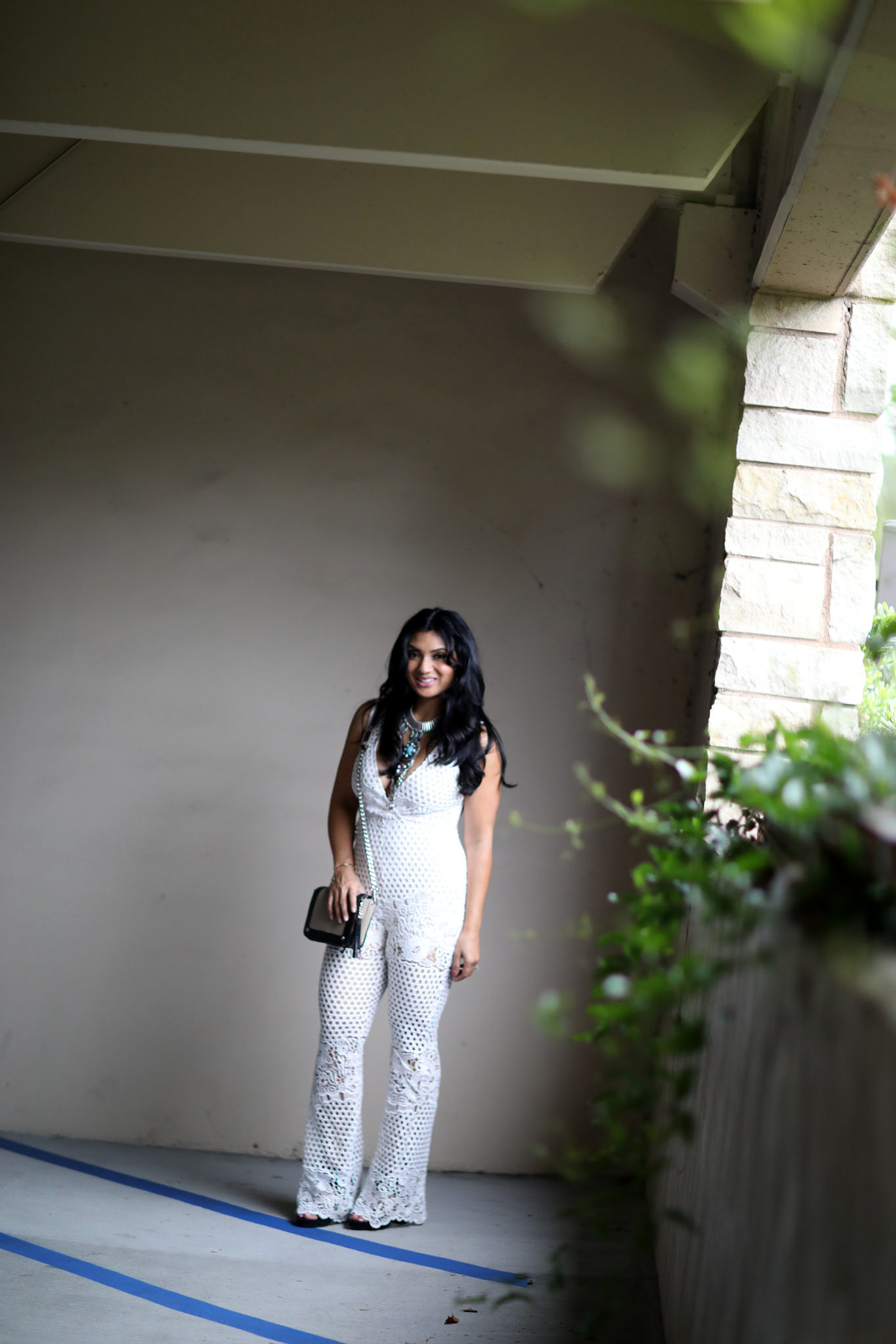 Stylish Vacation Outfit: White Crochet Jumpsuit