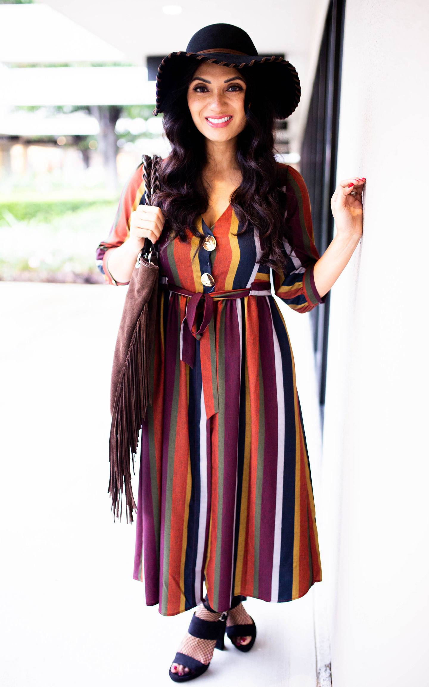 Curious how to style a multi-stripe dress? Orange County Blogger Debbie Savage is sharing her favorite way to style a multi-stripe dress. See how here!