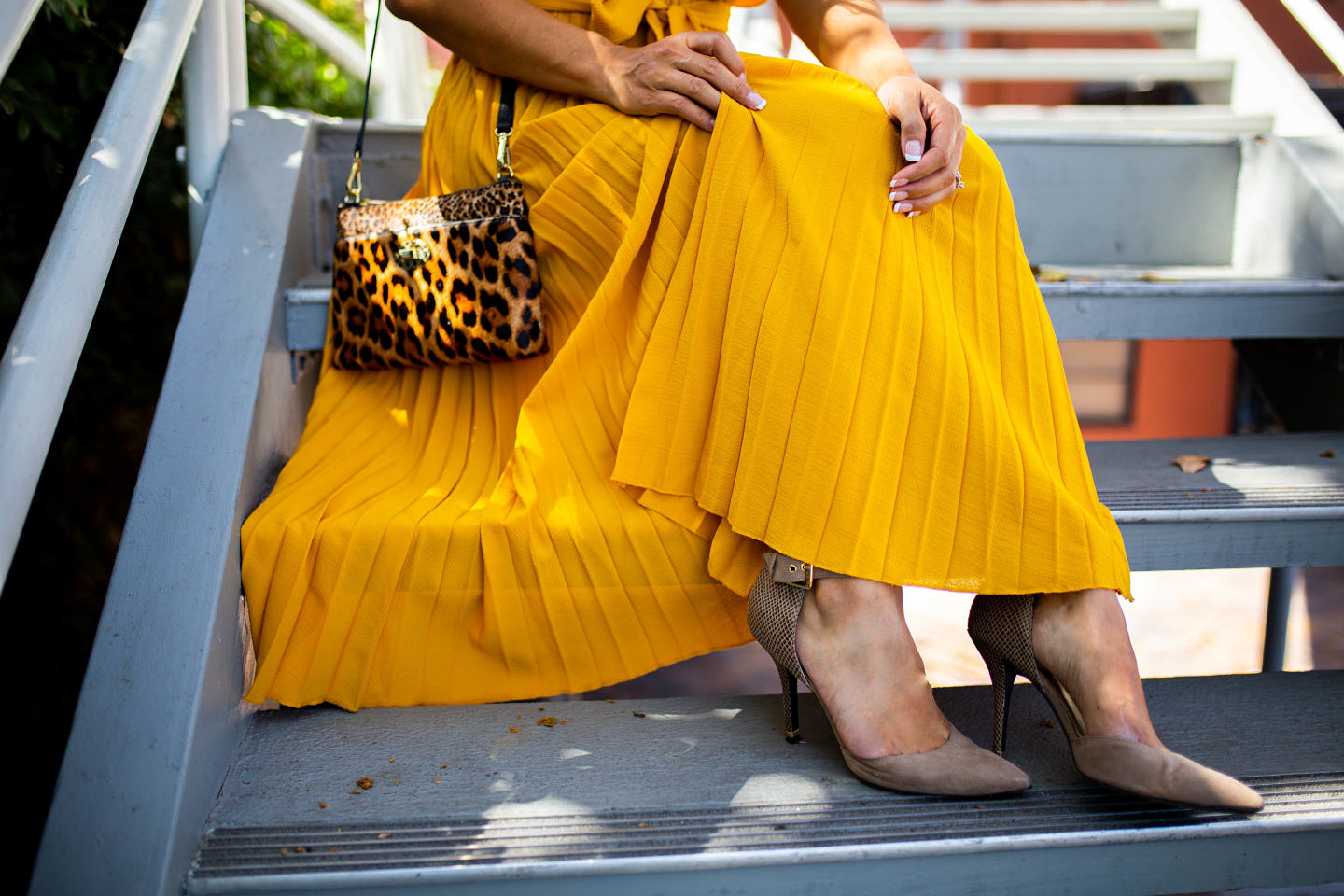 Bookmark this post ASAP if you have wanted to style a yellow pleated dress this holiday season! Keep reading as Orange County Blogger Debbie Savage share her favorite way to style a yellow pleated dress like a pro.