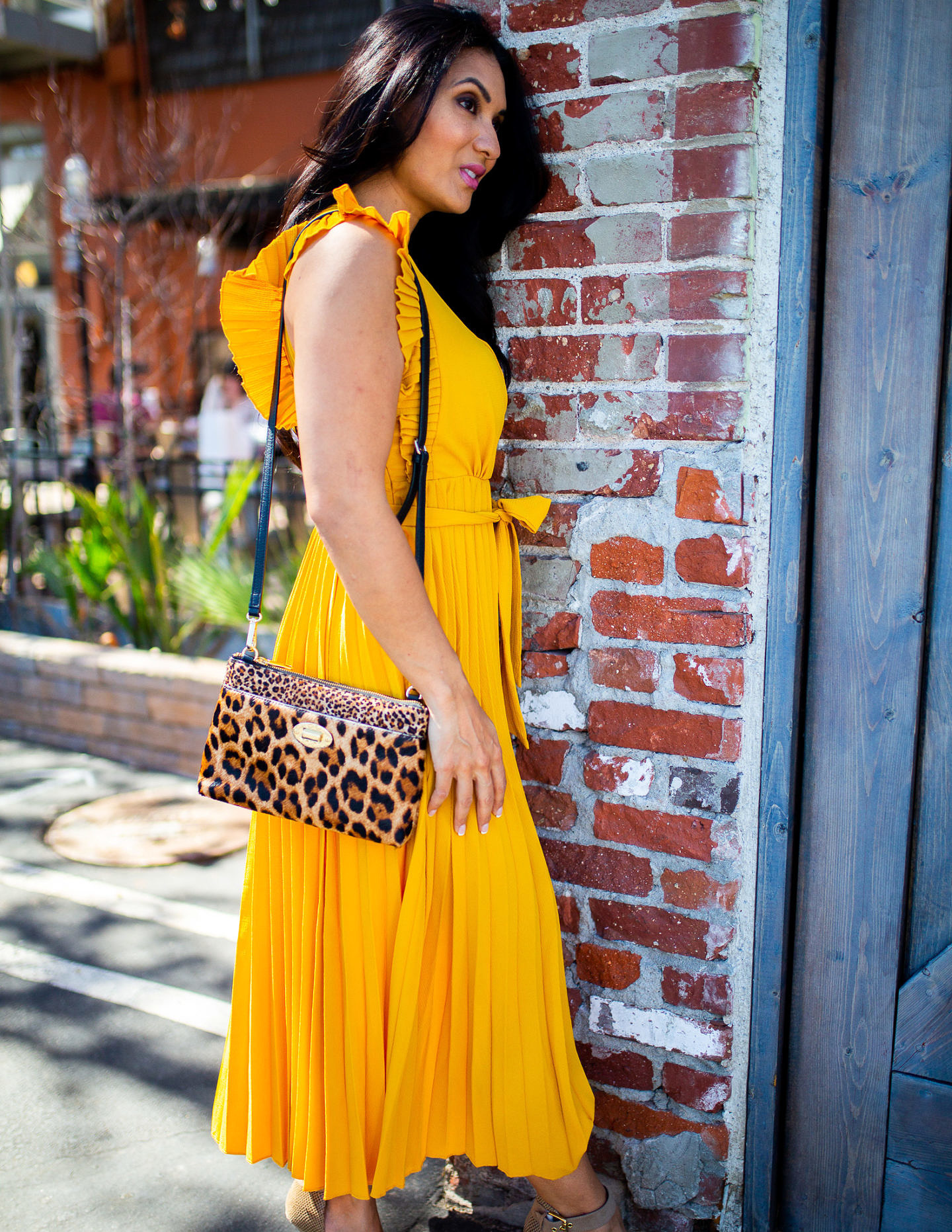 Curious how to incorporate a yellow pleated dress into your wardrobe? Orange County Blogger Debbie Savage is sharing her favorite way to style a yellow pleated dress here!