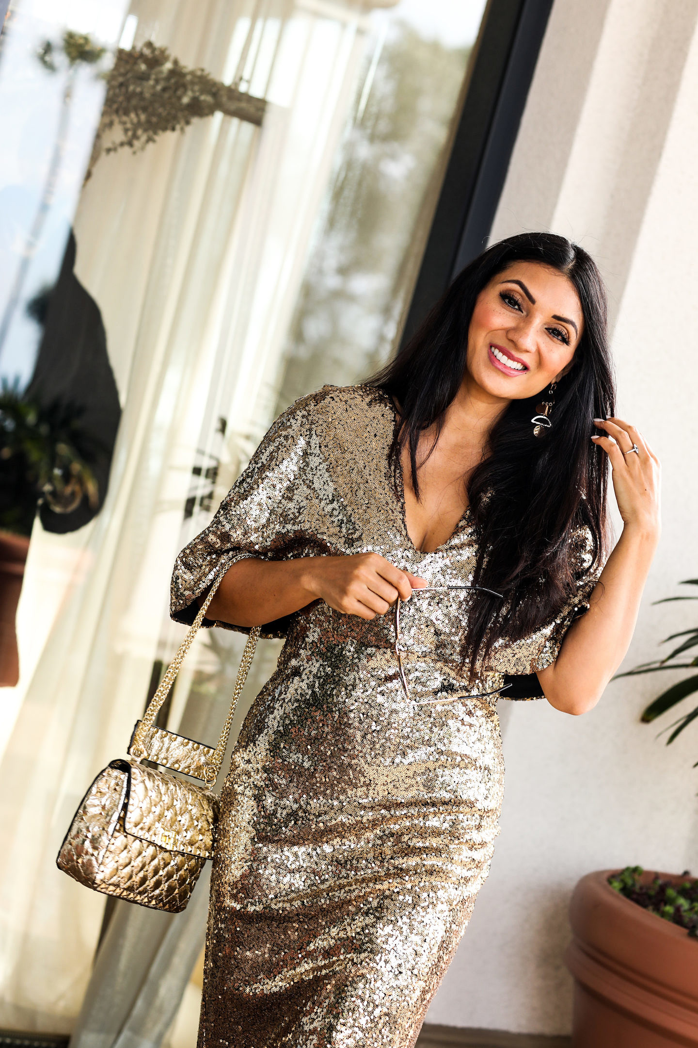 Looking for the perfect NYE outfit? Orange County Blogger Debbie Savage is sharing her sparkly New Year's Eve Outfit Ideas here! Click to see them!