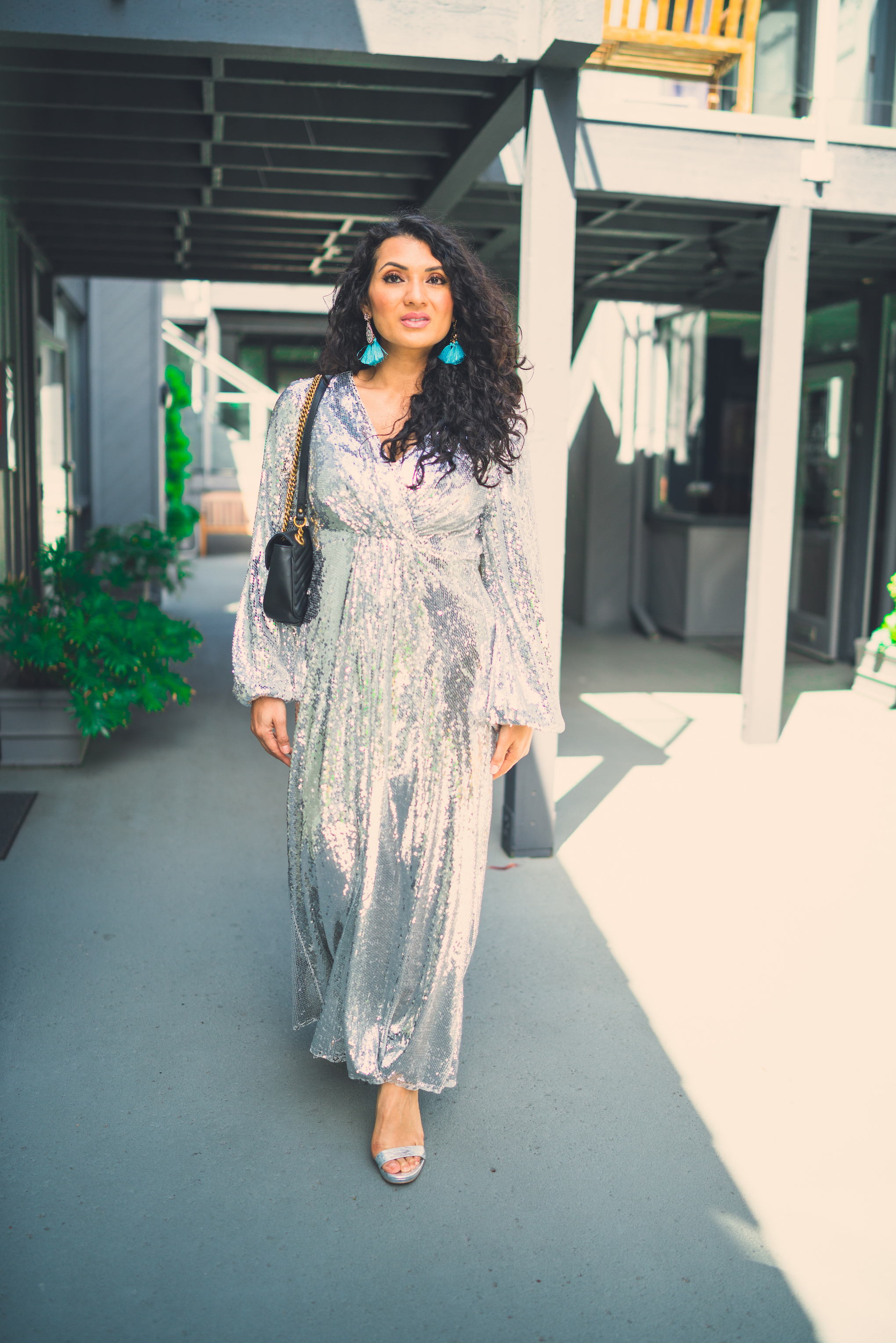 Bring on the glam with the perfect metallic sequin maxi dress! Curious how to style one? Orange County Blogger Debbie Savage is sharing how to style one. Click to see how HERE!