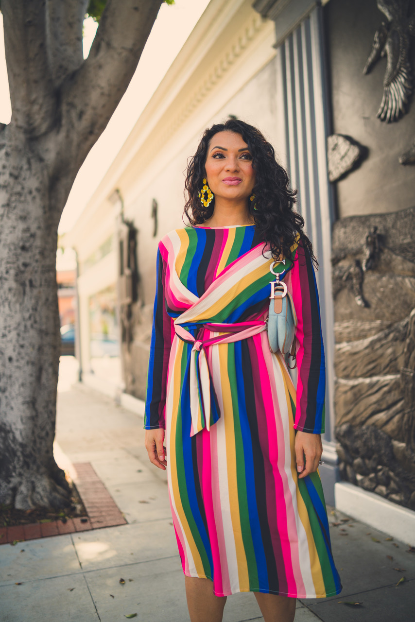 Not sure how to style a rainbow printed dress? Orange County Blogger Debbie Savage is sharing her favorite way to rock and style a rainbow printed dress. See how HERE!